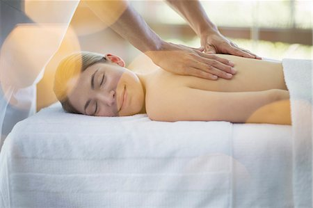 Woman receiving massage at spa Stock Photo - Premium Royalty-Free, Code: 6113-07147359