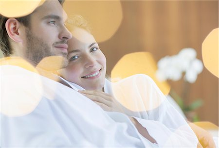 Couple hugging in bathrobes Stock Photo - Premium Royalty-Free, Code: 6113-07147371