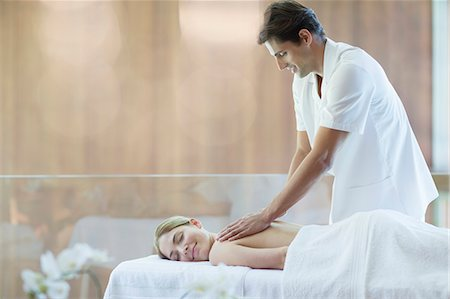 Woman receiving massage at spa Stock Photo - Premium Royalty-Free, Code: 6113-07147378