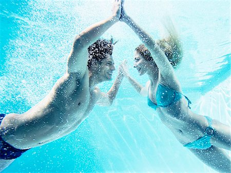pool - Couple touching hands underwater Stock Photo - Premium Royalty-Free, Code: 6113-07147399