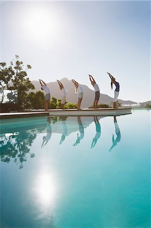 People practicing yoga at poolside Stock Photo - Premium Royalty-Free, Code: 6113-07147441