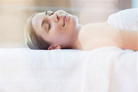 Woman laying on massage table in spa Stock Photo - Premium Royalty-Free, Code: 6113-07147448