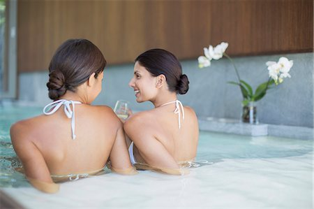 Women relaxing together in spa pool Stock Photo - Premium Royalty-Free, Code: 6113-07147453