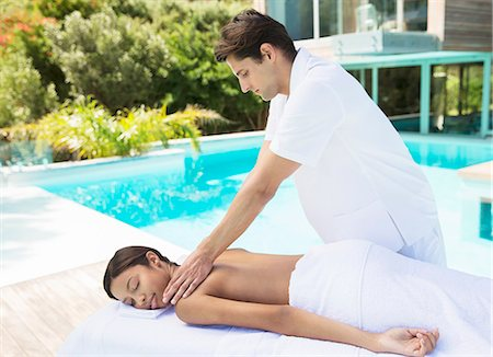 Woman receiving massage poolside at spa Stock Photo - Premium Royalty-Free, Code: 6113-07147460