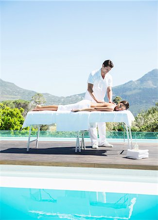 Woman receiving massage at poolside Stock Photo - Premium Royalty-Free, Code: 6113-07147408