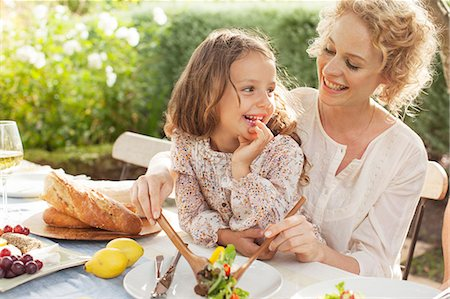 people eating at lunch - Mother and daughter eating in garden Stock Photo - Premium Royalty-Free, Code: 6113-07147647