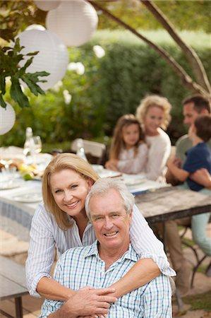 Portrait of smiling senior couple on patio Stock Photo - Premium Royalty-Free, Code: 6113-07147645
