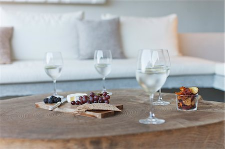 Wine and cheese on wooden coffee table Stock Photo - Premium Royalty-Free, Code: 6113-07147606