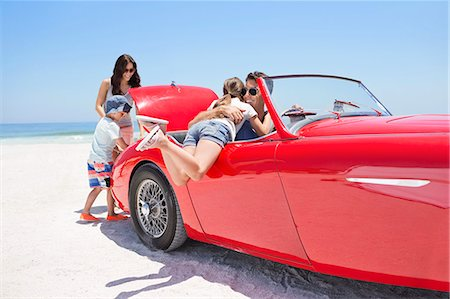 Family packing convertible on beach Stock Photo - Premium Royalty-Free, Code: 6113-07147744