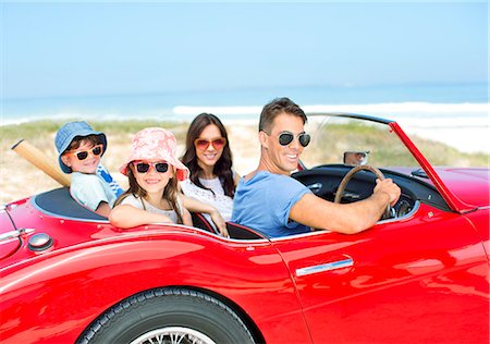 sunglasses - Portrait of smiling family in convertible at beach Stock Photo - Premium Royalty-Free, Code: 6113-07147702