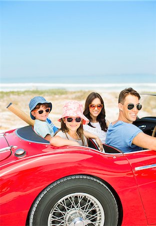 dark glasses - Portrait of smiling family in convertible at beach Stock Photo - Premium Royalty-Free, Code: 6113-07147708