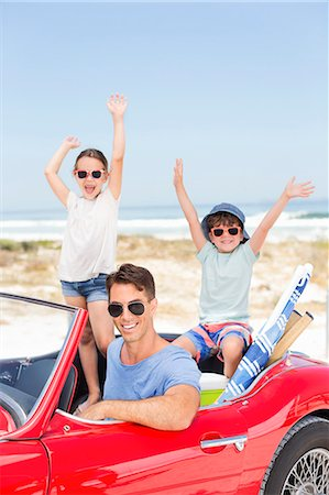 dark glasses - Father and children in convertible at beach Stock Photo - Premium Royalty-Free, Code: 6113-07147722