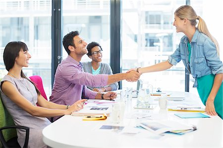Business people shaking hands in meeting Stock Photo - Premium Royalty-Free, Code: 6113-07147901