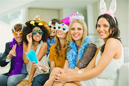 Friends wearing decorative glasses and headpieces at party Stock Photo - Premium Royalty-Free, Code: 6113-07148073