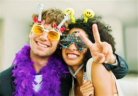 sign - Couple wearing decorative glasses at party Stock Photo - Premium Royalty-Free, Code: 6113-07148072