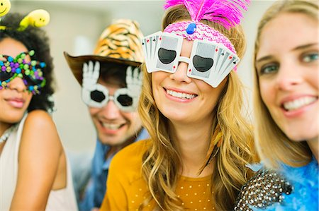 funny pose - Friends wearing decorative glasses at party Stock Photo - Premium Royalty-Free, Code: 6113-07148077