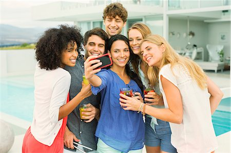 Friends taking picture together at party Stock Photo - Premium Royalty-Free, Code: 6113-07148013