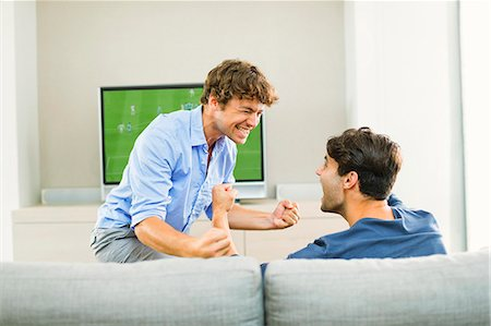 entertainment - Men cheering and watching soccer game Stock Photo - Premium Royalty-Free, Code: 6113-07148014