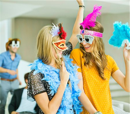 Women wearing decorative glasses and headpieces at party Stock Photo - Premium Royalty-Free, Code: 6113-07148028