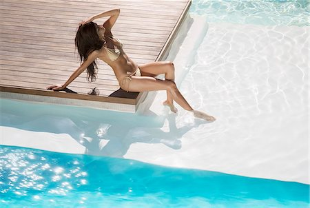sexi women full body - Woman relaxing at swimming pool Stock Photo - Premium Royalty-Free, Code: 6113-07158879