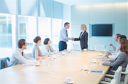 Business people shaking hands in meeting Stock Photo - Premium Royalty-Free, Code: 6113-07158963