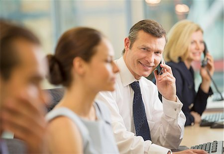Business people working in office Stock Photo - Premium Royalty-Free, Code: 6113-07158907