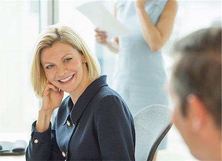 Business people talking in meeting Stock Photo - Premium Royalty-Free, Code: 6113-07158911