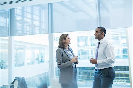 Business people talking in office Stock Photo - Premium Royalty-Free, Code: 6113-07158931