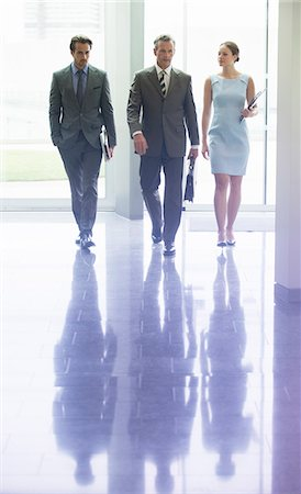Business people walking in office lobby Stock Photo - Premium Royalty-Free, Code: 6113-07159044