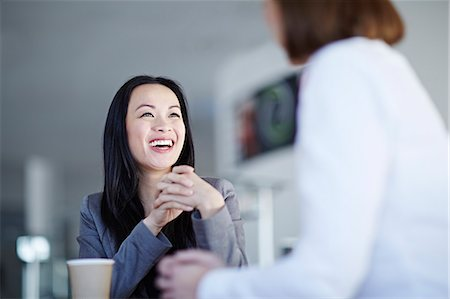 Business people talking in office Stock Photo - Premium Royalty-Free, Code: 6113-07159069