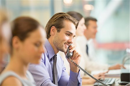 Businessman talking on telephone in office Stock Photo - Premium Royalty-Free, Code: 6113-07159011
