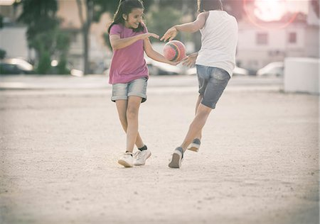 female playing soccer - Children playing in sand Stock Photo - Premium Royalty-Free, Code: 6113-07159146