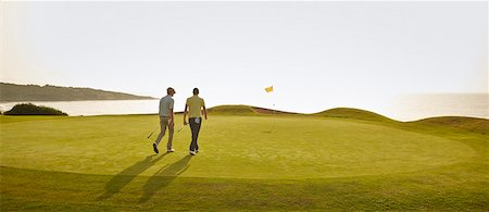 Men walking on golf course Stock Photo - Premium Royalty-Free, Code: 6113-07159185