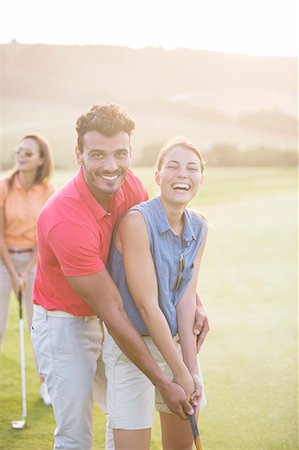 Couple playing golf on course Stock Photo - Premium Royalty-Free, Code: 6113-07159188