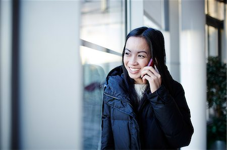 Woman talking on cell phone Stock Photo - Premium Royalty-Free, Code: 6113-07159104