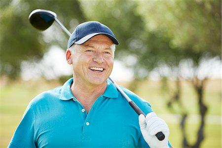 Senior man holding golf club Stock Photo - Premium Royalty-Free, Code: 6113-07159260