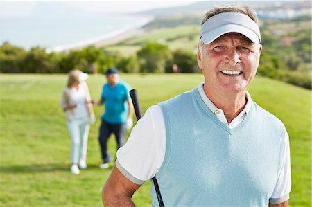 Smiling senior man on golf course Stock Photo - Premium Royalty-Free, Code: 6113-07159278