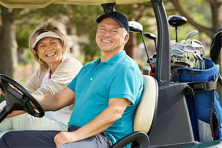 Senior couple smiling in golf cart Stock Photo - Premium Royalty-Free, Code: 6113-07159284