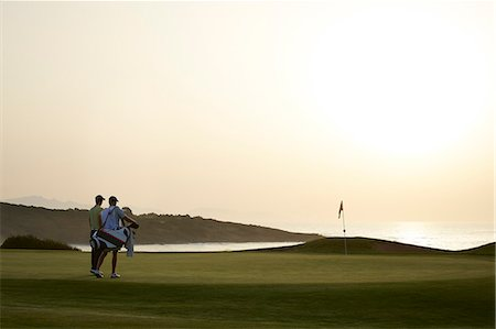 Men on golf course at sunset Stock Photo - Premium Royalty-Free, Code: 6113-07159289