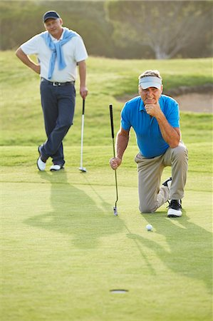 Senior men on golf course Stock Photo - Premium Royalty-Free, Code: 6113-07159291