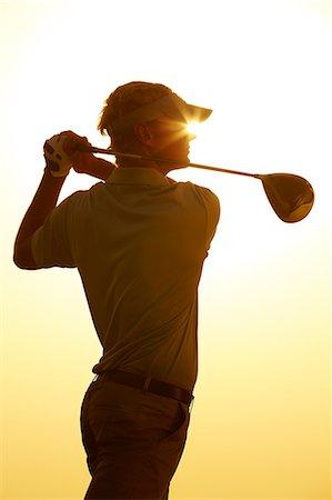 swing (sports) - Silhouette of man swinging golf club Stock Photo - Premium Royalty-Free, Code: 6113-07159292