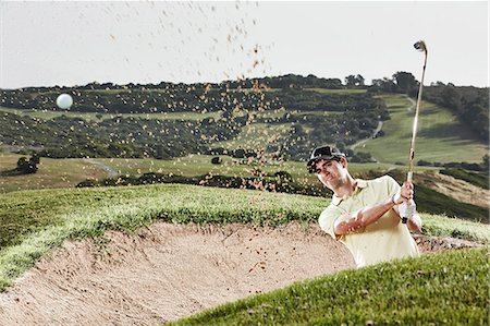 swing (sports) - Man swinging from sand trap on golf course Stock Photo - Premium Royalty-Free, Code: 6113-07159201