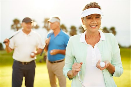 Senior friends on golf course Stock Photo - Premium Royalty-Free, Code: 6113-07159206