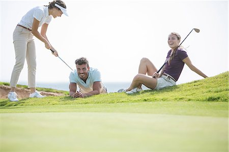 Friends playing on golf course Stock Photo - Premium Royalty-Free, Code: 6113-07159213