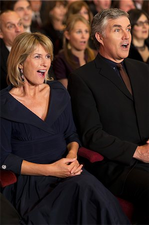 Surprised couple in theater audience Stock Photo - Premium Royalty-Free, Code: 6113-07159358