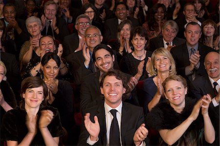 Clapping theater audience Stock Photo - Premium Royalty-Free, Code: 6113-07159370