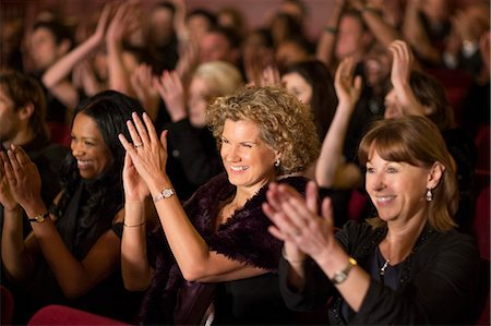 Clapping theater audience Stock Photo - Premium Royalty-Free, Code: 6113-07159374