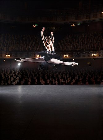 Ballerina mid-air on theater stage Stock Photo - Premium Royalty-Free, Code: 6113-07159388