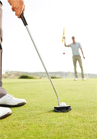 Man putting golf ball Stock Photo - Premium Royalty-Free, Code: 6113-07159308
