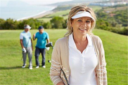 Senior friends on golf course Stock Photo - Premium Royalty-Free, Code: 6113-07159327